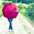 Teenage girl with red umbrella — Stock Photo #26635213