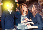 Group of friends in a night сlub — Stock Photo