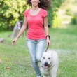 Young Woman Running with Her Dog — Stock Photo