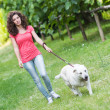 Young Woman Walking with Her Dog — Stok fotoğraf