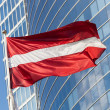 Latvian Flag against Skyscraper in Riga — Stock Photo