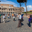 Stock Photo: Tourists in front of Coliseum in Rome, Italy.
