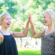 Two Beautiful Blonde Girl giving High Five — Stock Photo