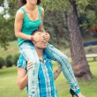 Young Couple having Piggyback Ride — Photo