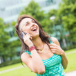 Stock Photo: Happy Young Woman Talking on Mobile Phone