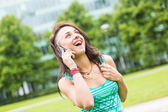 Happy Young Woman Talking on Mobile Phone — Stock Photo