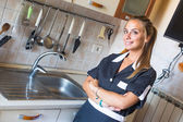Happy Housemaid with Clean Kitchen — Stock Photo