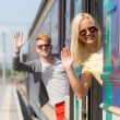 Couple Leaving for Vacation with Train — Stock Photo #27693927