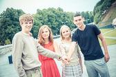 Gruppo di amici con le mani sullo stack — Foto Stock