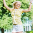 Stock Photo: Happy Young Woman Jumping