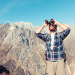 Stock Photo: Young Mwith Binocular at Mountain