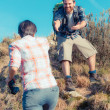 Стоковое фото: MHelping His Girlfriend Hiking