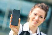 Young Businesswoman Showing Mobile Phone — Foto de Stock