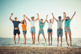 Multiethnic Group of People Jumping at Beach — Stock fotografie