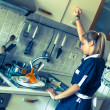 Housemaid Washing Dishes in the Kitchen — Stock Photo