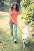 Young Woman Walking with Her Dog — Stock Photo