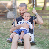 Little Boy Playing on the Swing with Father or Uncle — Stock Photo