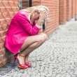 Depressed Woman Against Wall in the City — Stock Photo