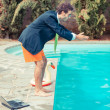 Funny Young Businessman with SwimmingTrunks Diving into the Poo — Stock Photo