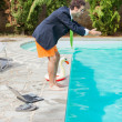Funny Young Businessman with SwimmingTrunks Diving into the Poo — Stock Photo #29938513