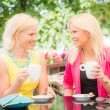 Two Beautiful Women Drinking Coffee at Bar — Stock Photo #30011411