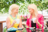 Two Beautiful Women Drinking Coffee at Bar — Stock Photo
