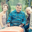 Adult Farmer with Children on Tractor — Stock Photo #30043409