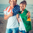American Boy with Brazilian Girl at Beach — Stock Photo
