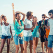 Group of Friends Having a Party on the Beach — Stock Photo