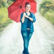 Teenage Girl with Red Umbrella — Stock Photo