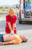 Rescuer Practicing Heart Massage — Stock Photo