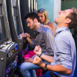 Group of Friend Playing with Slot Machines — 图库照片