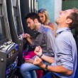 Group of Friend Playing with Slot Machines — Stockfoto