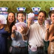 Friends Winning a lot of Money at Casino — Stock Photo