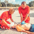 Stock Photo: Rescue Team Providing First Aid