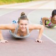 Group of People doing Stretching Exercises — Stock Photo #31480815