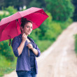 Stock Photo: Teenage Girl with Red Umbrella