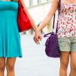 Two Women Holding Hands in the City — Stock Photo