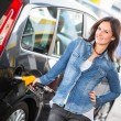 Stock Photo: Young Woman Filling Her Car at Gas Station