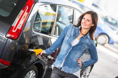 Young Woman Filling Her Car at Gas Station — Stock Photo
