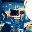 Pilot and Copilot Checking Flight Information on Digital Tablet — Foto de Stock