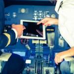 Pilot and Copilot Checking Flight Information on Digital Tablet — Stock Photo