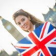 Young Woman Holding Union Jack in front of Big Ben — Foto Stock