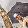 Mwith Swim Cap, Goggles and Umbrellin London — Stock Photo #34345663
