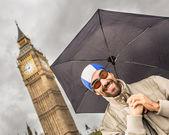 Man with Swim Cap, Goggles and Umbrella in London — Stock Photo