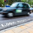 Stock Photo: Look Right Sign and Blurred Traffic in London