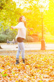 Joyful Young Woman at Park in Autumn — Stock Photo