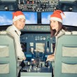 Stock Photo: Pilots in the Cockpit with Santa Hat