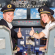 Stock Photo: Happy Pilots in the Cockpit with Thumbs Up