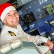 Stock Photo: Pilot in the Cockpit with Santa Hat